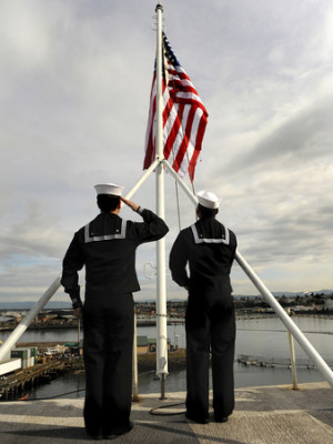 stocktrek-images-sailors-raise-the-national-ensign-aboard-uss-abraham-lincoln